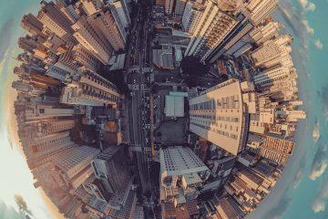 Foto aérea de uma cidade, representando a possibilidade de expandir o escritório e atender lugares mais distantes